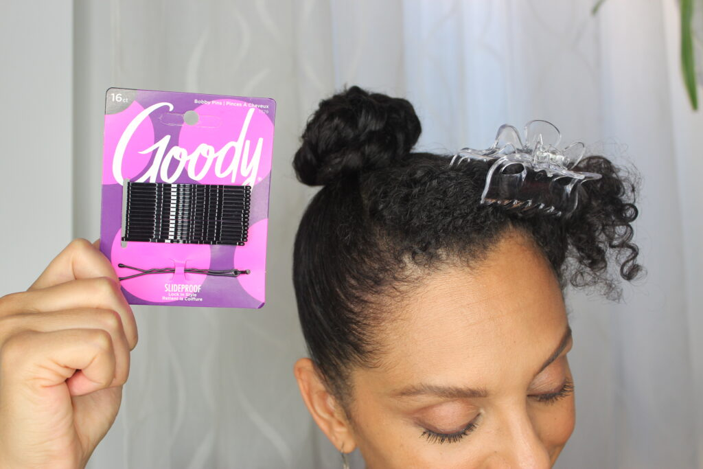 DiscoCurls holding Goody® SlideProof Bobby Pins